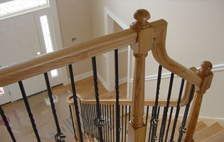 Wooden Staircase Iron Rails